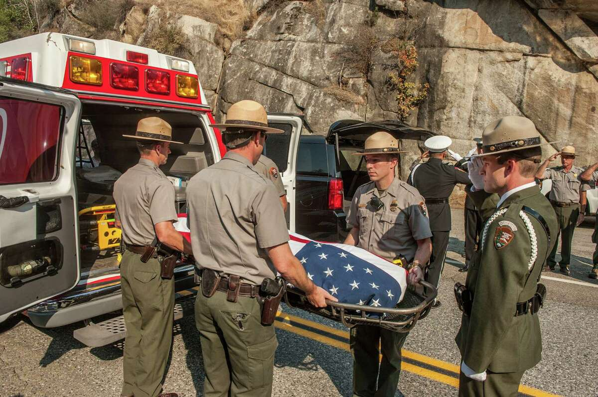 Yosemite National Park Rangers transfer the body of a Cal Fire pilot who was killed in an airplane crash in Yosemite National Park, Calif., on Wednesday, Oct. 8, 2014. Air tankers were grounded Wednesday in California after one of the aircraft crashed Tuesday into a steep canyon wall while fighting a blaze in Yosemite National Park, killing the pilot, officials said. The formal ceremony included the Cal Fire Honor Guard and marked the transition from Yosemite National Park to Cal Fire. (AP Photo/Al Golub)