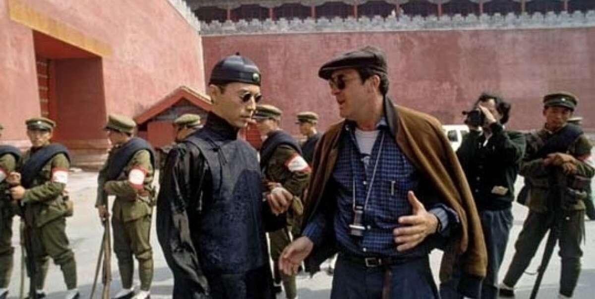 Bernardo Bertolucci (right) and John Lone on the