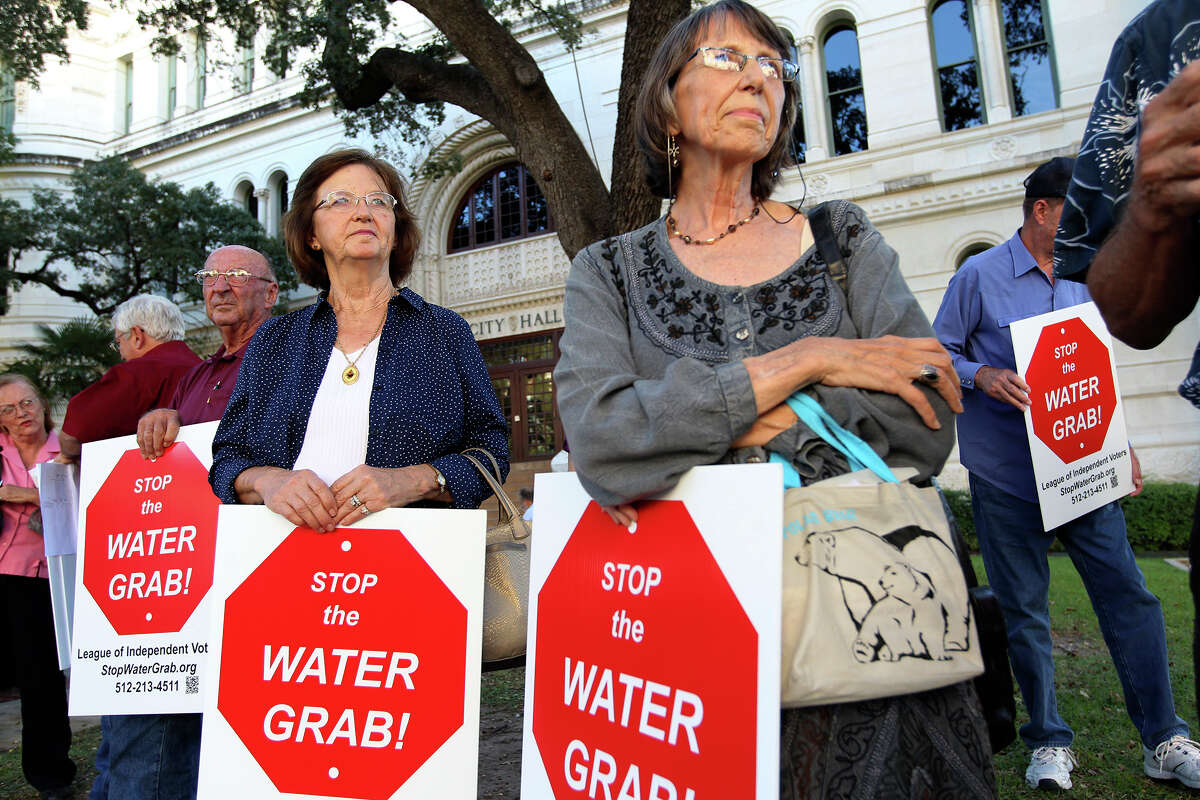 Rose Fritsche, left, of Lee County, and Charlotte Gilman, of Bastrop County, gather in front of City Hall before heading to speak against the proposed San Antonio Water Systems 142-mile water pipeline during a San Antonio City Council hearing, Wednesday, Oct. 8, 2014. The $3.4 billion pipeline would bring water from Burleson County, east of Austin, to San Antonio. It is expected to increase SAWS customers rate by as much as 17 percent.