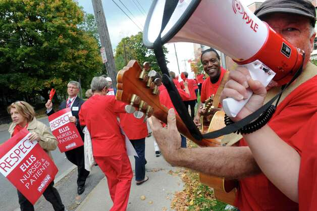 Local 802 Associated Musicians of Greater New York members Larry Siegel, right, and Eugene Key join nurses represented by the New York Nursing Association picketing outside Ellis Hospital on Wednesday Oct. 8, 2014 in Schenectady, N.Y.  (Michael P. Farrell/Times Union) Photo: Michael P. Farrell / 10028955A