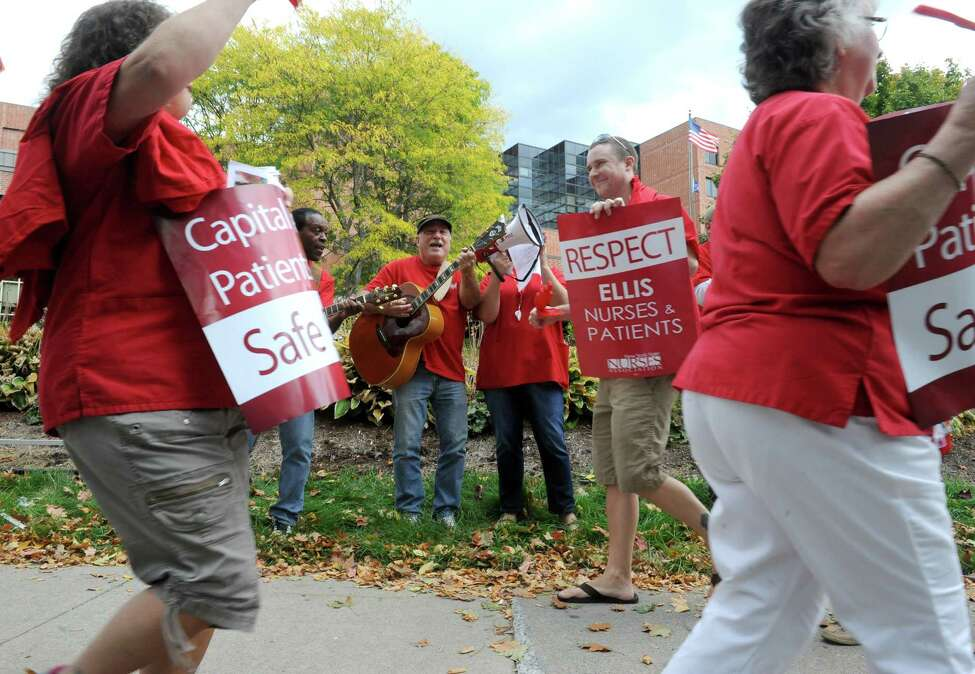 Local nurses represented by the New York Nursing Association and supporters picket outside Ellis Hospital on Wednesday Oct. 8, 2014 in Schenectady, N.Y. (Michael P. Farrell/Times Union)