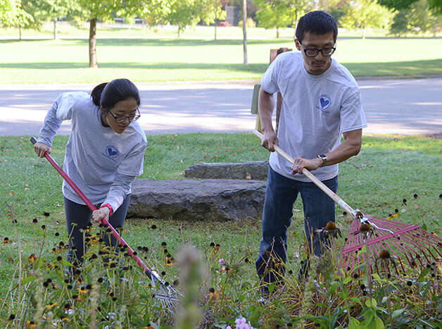 "Volunteers clean up Tawasentha Park in Altamont during ""Neighbors Helping Neighbors Day."" (Paulette Doudoukjian)"