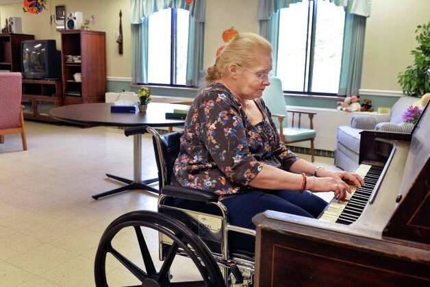 Maplewood Manor nursing home resident Judy Patterson plays a recently donated piano in a dining room on the second floor, where residents from the dementia unit spend their free time Wednesday Oct. 8, 2014, in Ballston Spa, NY.  (John Carl D'Annibale / Times Union) Photo: John Carl D'Annibale / 10028894A