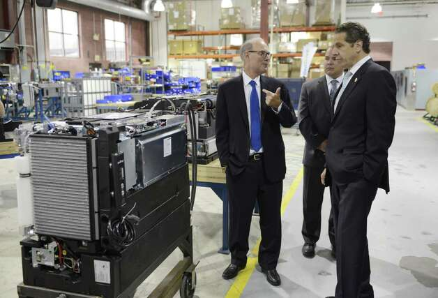 Plug Power CEO Andy Marsh, left, gives Gov. Andrew Cuomo a factory tour Wednesday, Oct. 8, 2014, at Plug Power in Colonie, N.Y., where the governor was endorsed by the state Business Council. (Will Waldron/Times Union) Photo: WW / 10028950A
