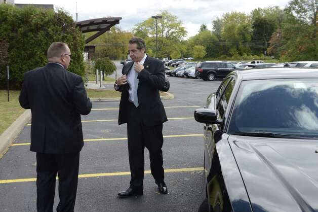 Gov. Andrew Cuomo arrives at Plug Power where he was endorsed by the state Business Council Wednesday, Oct. 8, 2014, in Colonie, N.Y. The governor traveled in a special unmarked police car. (Will Waldron/Times Union) Photo: WW / 10028950A