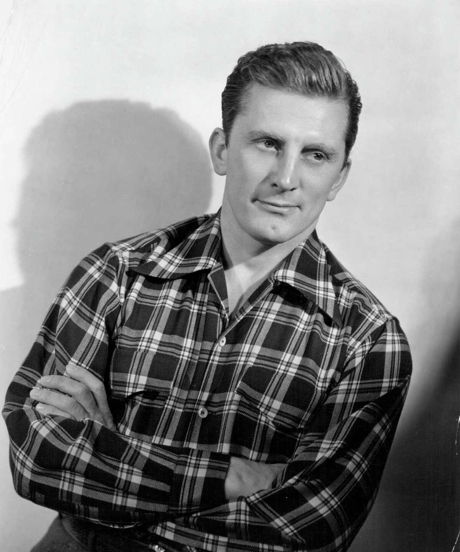 1940: Portrait of actor Kirk Douglas wearing a check shirt, circa 1940.