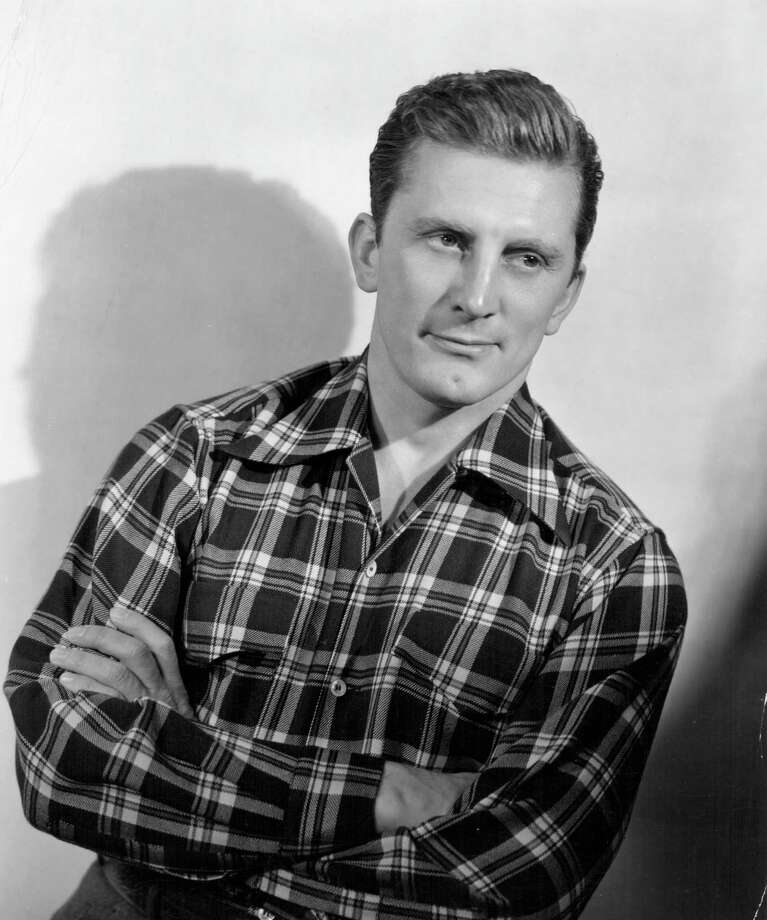 1940: Portrait of actor Kirk Douglas wearing a check shirt, circa 1940. Photo: Pictorial Parade, Getty Images / 2014 Getty Images