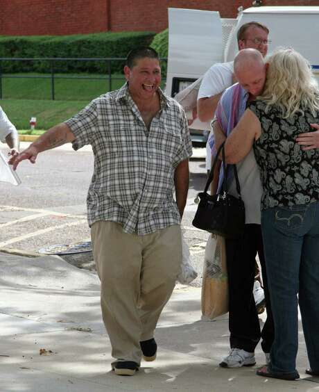 Former death row inmate Manuel Velez, left, emerges with other inmates released from the Texas Department of Criminal Justice Huntsville Unit in Huntsville. Photo: Michael Graczyk / Associated Press / AP