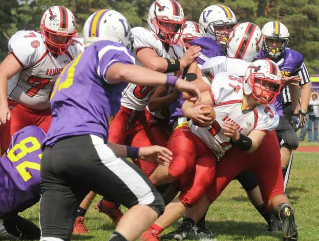 Mechanicville's Chase DeLossantos runs for a gain during their boy's high school football game against Voorheesville on Saturday Sept. 20, 2014 in Voorheesville, N.Y.  (Michael P. Farrell/Times Union) Photo: Michael P. Farrell / 00028673A
