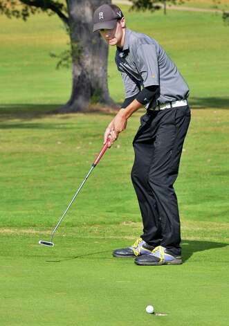 Ballston Spa's Jake DeVito sinks a putt on the 18th green during the Section II golf Class A championship at the Ballston Spa Country Club Wednesday Oct. 8, 2014, in Ballston Spa, NY.  (John Carl D'Annibale / Times Union) Photo: John Carl D'Annibale / 10028920A