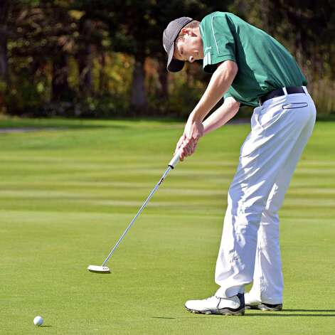 Shen's Tommy McPartlon putts during the Section II golf Class A championship at the Ballston Spa Country Club Wednesday Oct. 8, 2014, in Ballston Spa, NY.  (John Carl D'Annibale / Times Union) Photo: John Carl D'Annibale / 10028920A