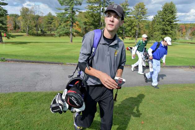 Ballston Spa's Jake DeVito, left, leaves the 18th green with Shen's Mason Munger and Saratoga's Dan Shepard during the Section II golf Class A championship at the Ballston Spa Country Club Wednesday Oct. 8, 2014, in Ballston Spa, NY.  (John Carl D'Annibale / Times Union) Photo: John Carl D'Annibale / 10028920A