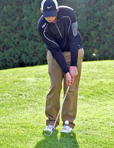 Colonie's Christian Ristau chips onto the 8th green during the Section II golf Class A championship at the Ballston Spa Country Club Wednesday Oct. 8, 2014, in Ballston Spa, NY.  (John Carl D'Annibale / Times Union) Photo: John Carl D'Annibale / 10028920A