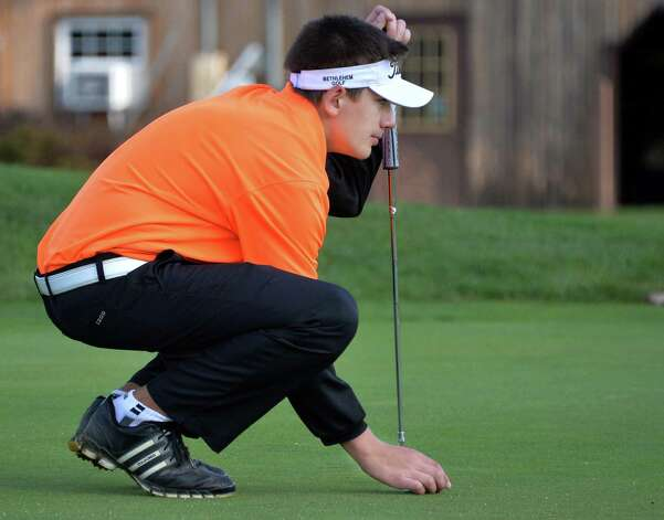 Bethlehem's Austen Fox lines up a putt during the Section II golf Class A championship at the Ballston Spa Country Club Wednesday Oct. 8, 2014, in Ballston Spa, NY.  (John Carl D'Annibale / Times Union) Photo: John Carl D'Annibale / 10028920A