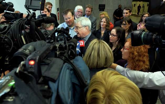 Steven Wise, founder and president of the Nonhuman Rights Project, is surrounded by media representing local and international outlets after he presented his case of the imprisoned chimp before the Appellate Division panel Wednesday afternoon, Oct. 8, 2014, in Albany, N.Y.  Wise believes Tommy, an imprisoned chimp, should be legally declared a person. (Skip Dickstein/Times Union) Photo: SKIP DICKSTEIN / 10028952A