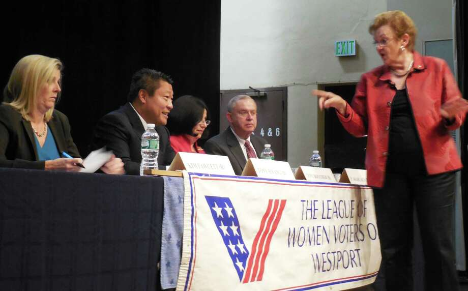 Moderator Kay Maxwell, standing, goes over some of the ground rules prior to the Candidates Debate  Wednesday night in the Town Hall auditorium. From left are State Rep. Kim Fawcett, D-133; State Rep. Tony Hwang, R-134; State Sen. Toni Boucher, R-26 and Philip Sharlach, a Democrat. Photo: Anne M. Amato / westport news