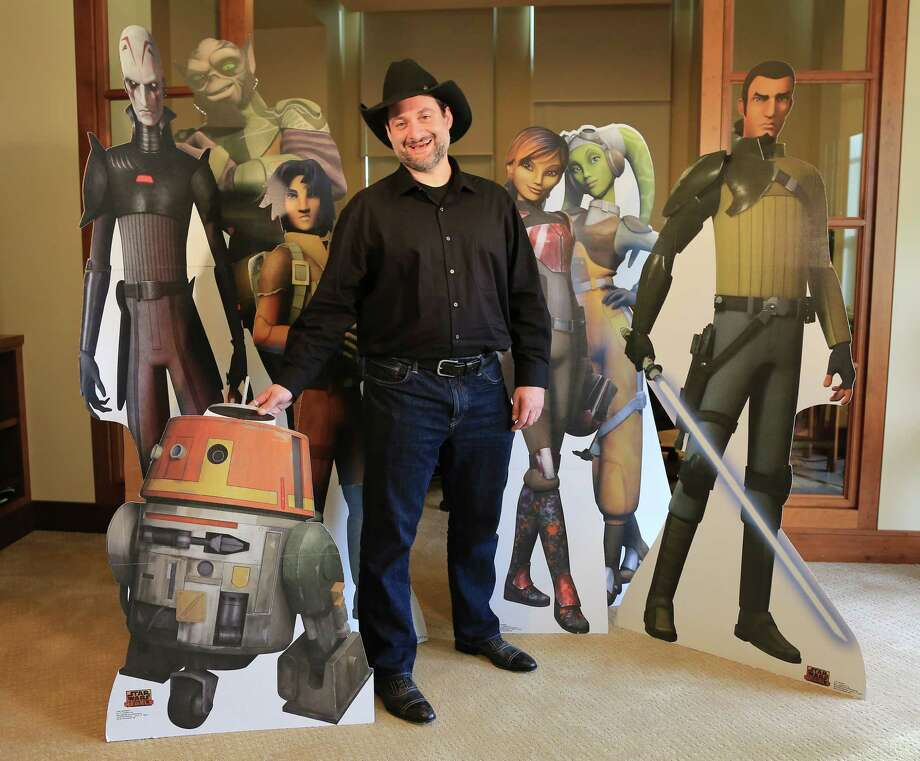 """Dave Filoni, the creator of a new animated television series, """"Star Wars Rebels,"""" with some of the show's characters at the offices of Lucasfilm in San Francisco, Sept. 16, 2014. """"Rebels"""" makes its cable debut early next month, not only representing a dramatic shift back to non-prequel stories, but also formally ushering in the studio's Disney era. (Jim Wilson/The New York Times) PHOTO MOVED IN ADVANCE AND NOT FOR USE - ONLINE OR IN PRINT - BEFORE SEPT. 28, 2014. Photo: JIM WILSON / New York Times / NYTNS"""