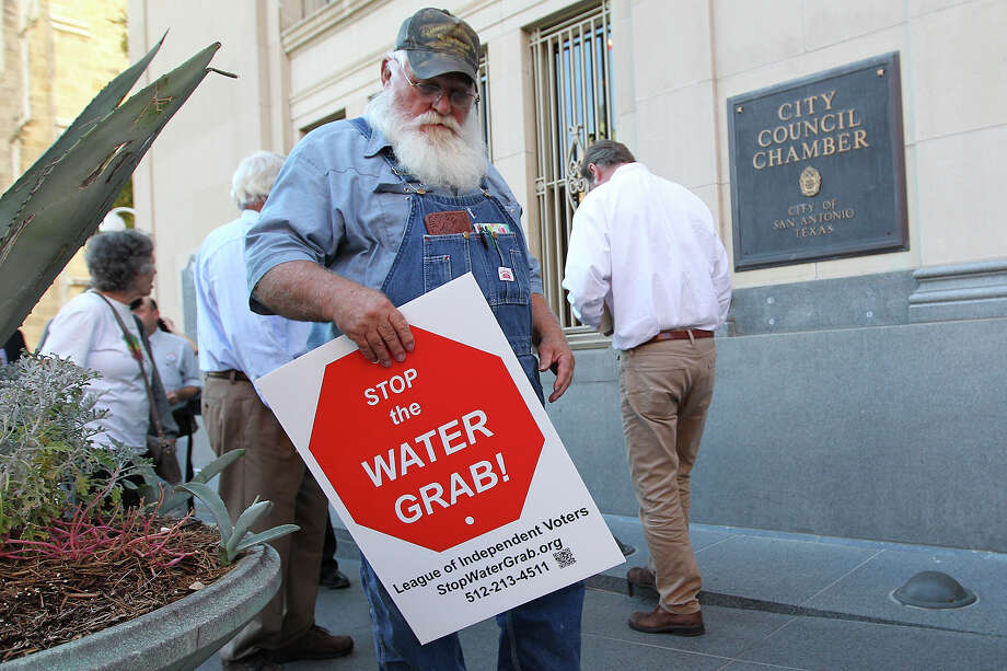 Henry Urban, of Lee and Bastrop Counties enters City Council Chamber to lend his opposition to the proposed San Antonio Water Systems 42-mile water pipeline during a San Antonio City Council hearing, Wednesday, Oct. 8, 2014. The $3.4 billion pipeline, known as the Vista Ridge Water Supply Project would bring water from Burleson County, east of Austin, to San Antonio. It is expected to increase SAWS customers rate by as much as 17 percent. Photo: San Antonio Express-News / © 2014 San Antonio Express-News