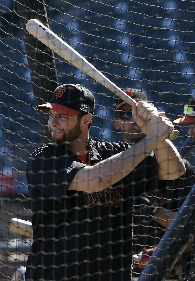 San Francisco Giant' Brandon Belt takes batting practice in San Francisco, Wednesday, Oct. 8, 2014. The Giants will play the St. Louis Cardinals in baseball's NL Championship Series. (AP Photo/Jeff Chiu) Photo: Jeff Chiu, Associated Press