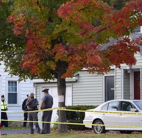 State troopers remained at the scene of a quadruple homicide on Western Avenue in Guilderland as detectives and evidence technicians try to determine who killed the two adults and two children found inside. (Skip Dickstein / Times Union)