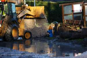 A Houston Public Works crew repairs a broken water main Thursday morning in the 6200 block of West Airport.