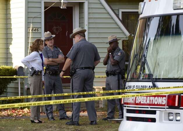 An investigator joins the team at the murder scene in Guilderland on Thursday. (Skip Dickstein / Times Union)