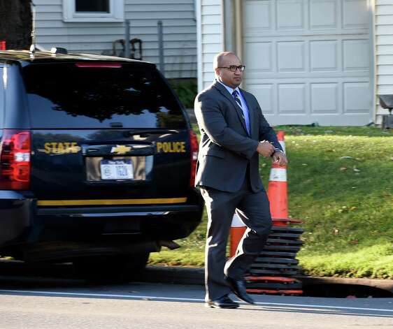 Albany County District Attorney David Soares returns to the scene of a quadruple homicide at 1846 Western Avenue early Thursday morning Oct. 9, 2014 in Guilderland, N.Y.     (Skip Dickstein/Times Union) Photo: SKIP DICKSTEIN / 10028967A