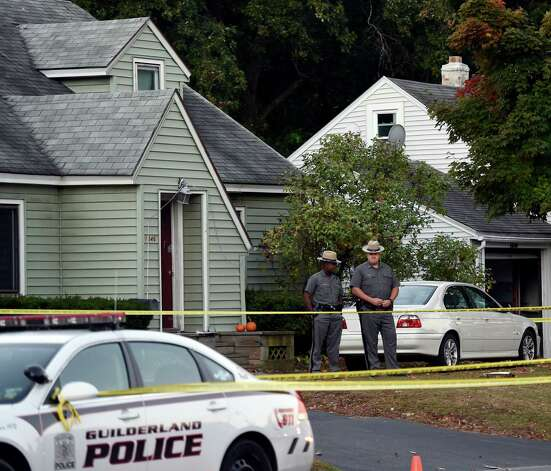 New York State Police troopers secure the scene of a quadruple homicide at 1846 Western Avenue early Thursday morning Oct. 9, 2014 in Guilderland, N.Y.     (Skip Dickstein/Times Union) Photo: SKIP DICKSTEIN / 10028967A