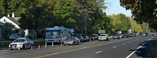 Rush hour traffic is backed up as a result of a lane closure at the scene of a quadruple homicide at 1846 Western Avenue early Thursday morning Oct. 9, 2014 in Guilderland, N.Y.     (Skip Dickstein/Times Union) Photo: SKIP DICKSTEIN / 10028967A