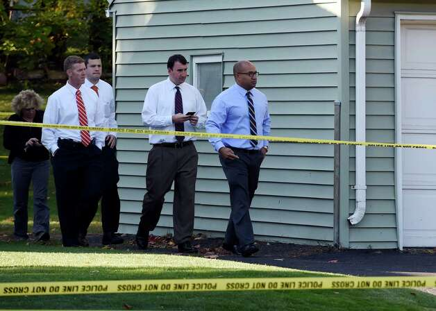 Albany County District Attorney David Soares, right, leads ADA David Rossi, second from right and other members of his team from the scene of a quadruple homicide at 1846 Western Avenue early Thursday morning Oct. 9, 2014 in Guilderland, N.Y.     (Skip Dickstein/Times Union) Photo: SKIP DICKSTEIN / 10028967A
