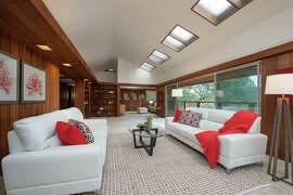Skylights, built-in shelving and a sliding glass door opening to a balcony are among the living room's inclusions.