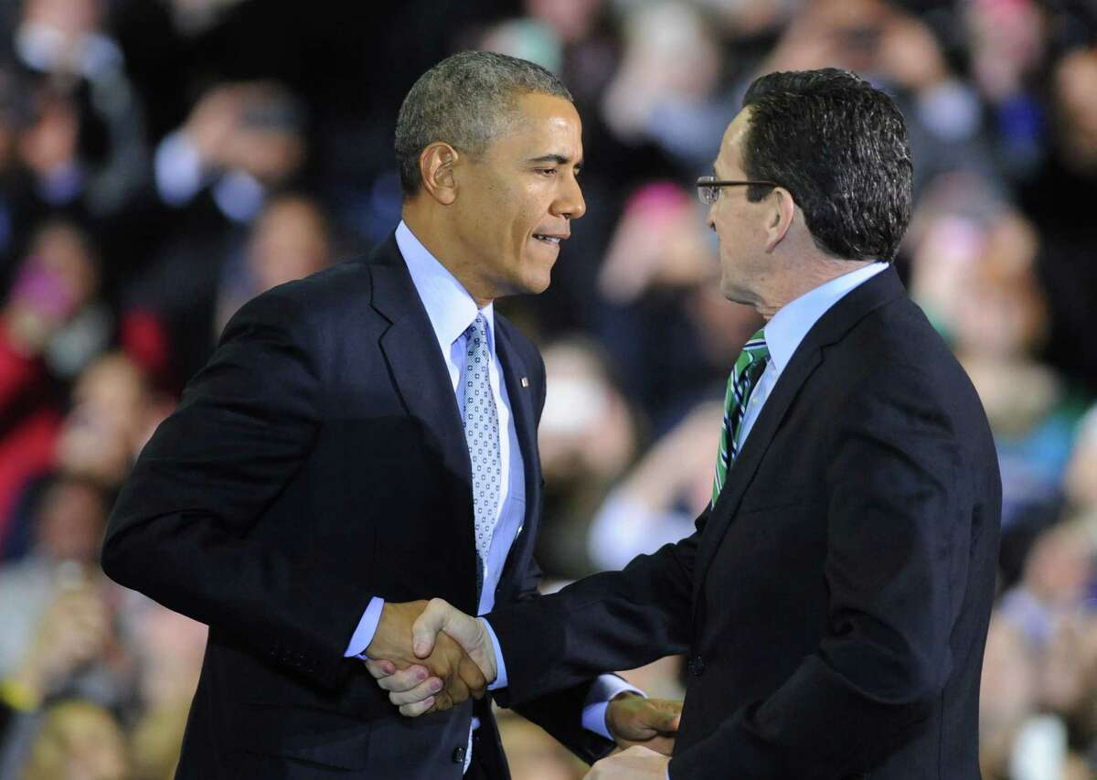 President Barack Obama shakes hands with Connecticut Governor Dannel P. Malloy before speaking at Kaiser Hall Gymnasium on the campus of Central Connecticut State University in New Britain, Conn. Wednesday, March 5, 2014. President Obama discussed his support to raise the minimum wage to $10.10 and was joined by Vermont Governor Peter Shumlin, Rhode Island Governor Lincoln Chafee, Massachusetts Governor Deval Patrick and Connecticut Governor Dannel P. Malloy.
