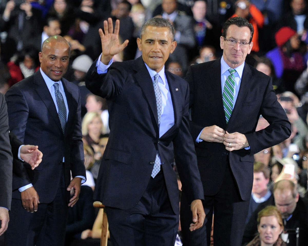 President Barack Obama waves to the crowd, joined by Massachusetts Governor Deval Patrick, left, and Connecticut Governor Dannel P. Malloy, right, after speaking at Kaiser Hall Gymnasium on the campus of Central Connecticut State University in New Britain, Conn. Wednesday, March 5, 2014. The President is expected to be in Bridgeport, Conn. on Wednesday Oct 15, 2014.