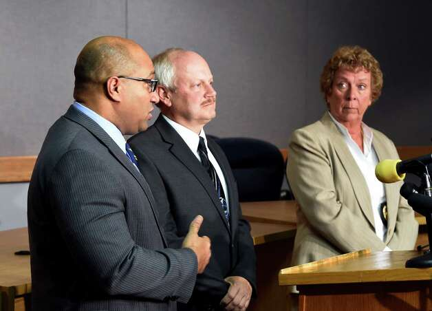 Albany County District Attorney David Soares, left, leads a press conference answering questions about Wednesday's quadruple homicide at 1846 Western Avenue Thursday morning, Oct. 9, 2014, in Guilderland, N.Y.  With Soares is NYSP BCI Captain Scott Coburn, center, and Guilderland Police Chief Carol Lawlor, right.  (Skip Dickstein/Times Union) Photo: SKIP DICKSTEIN / 10028971A