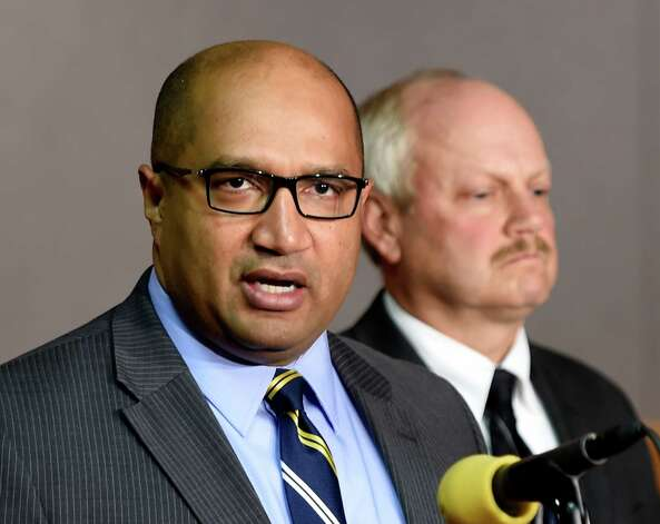 Albany County District Attorney David Soares, left, leads a press conference answering questions about Wednesday's quadruple homicide at 1846 Western Avenue Thursday morning, Oct. 9, 2014, at Town Hall in Guilderland, N.Y. With Soares is NYSP BCI Captain Scott Coburn.  (Skip Dickstein/Times Union) Photo: SKIP DICKSTEIN / 10028971A