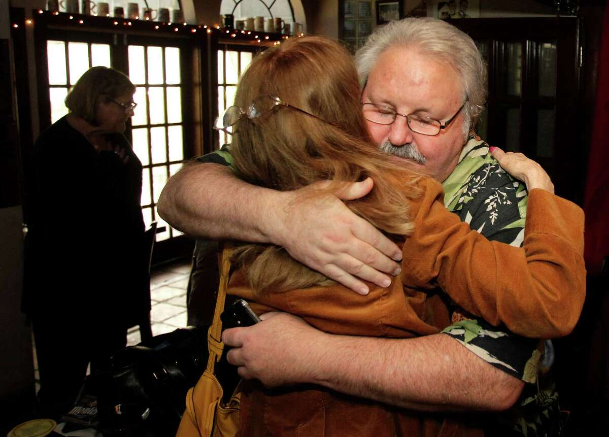 News 92 FM radio personalities Lana Hughes and Lanny Griffith hug after being laid off when KROI dropped its all-news format Wednesday.
