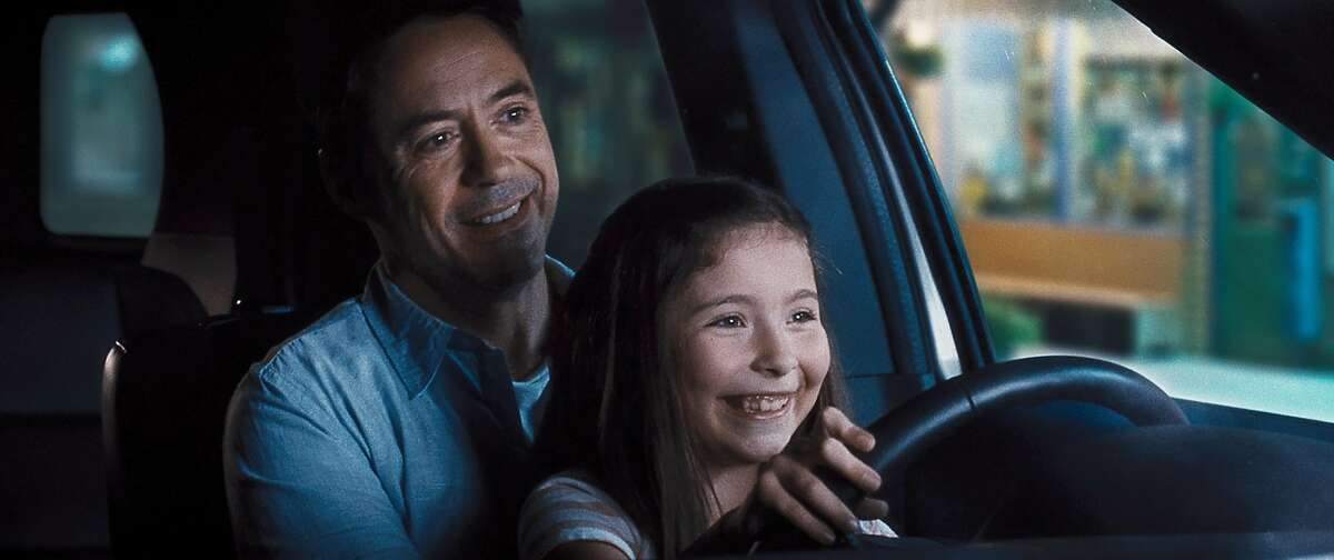 """This photo released by Warner Bros. Pictures shows, Robert Downey Jr., left, as Hank Palmer and Emma Tremblay as Lauren Palmer in Warner Bros. Pictures' and Village Roadshow Pictures' drama """"The Judge"""" a Warner Bros. Pictures release. The movie releases in the U.S. on Friday, Oct. 10, 2014. (AP Photo/Warner Bros. Pictures)"""