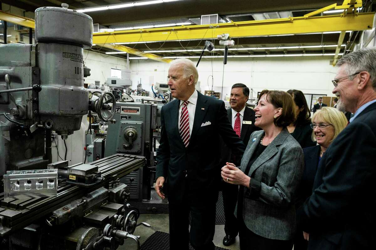Vice President Joe Biden tours the Renton Technical College, a recent recipient of a U.S. Department of Labor job-driven training grant, photographed Thursday, October 9, 2014, in Renton, Washington. The funding was part of the Trade Adjustment Assistance Community College and Career Training competitive grant program, which awarded more than $450 million to 270 community colleges across the country. The consortium that includes RTC received 10 million dollars in the latest round of funding.