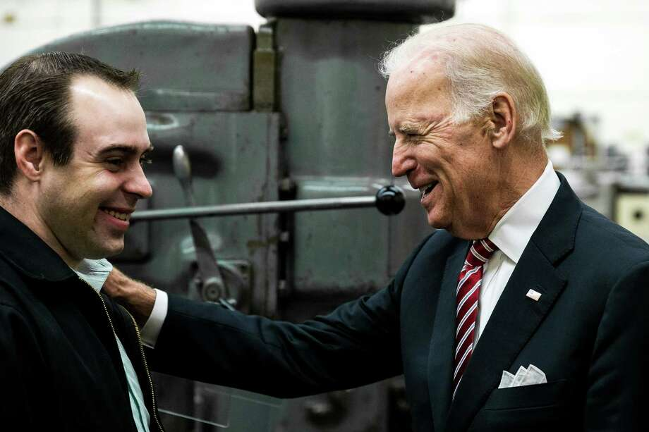 Vice President Joe Biden, right, chums it up with RTC recent graduate Sean Journot, left, during the VP's tour of the Renton Technical College, a recent recipient of a U.S. Department of Labor job-driven training grant, photographed Thursday, October 9, 2014, in Renton, Washington. The funding was part of the Trade Adjustment Assistance Community College and Career Training competitive grant program, which awarded more than $450 million to 270 community colleges across the country. The consortium that includes RTC received 10 million dollars in the latest round of funding. Photo: JORDAN STEAD, SEATTLEPI.COM / SEATTLEPI.COM