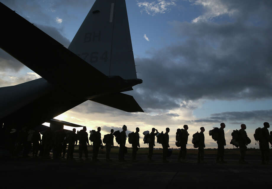 About 90 U.S. Marines arrive in Monrovia, Liberia, aboard transport aircraft that will be used to take part in the American effort to contain the Ebola epidemic in West Africa. Photo: John Moore / Getty Images / 2014 Getty Images