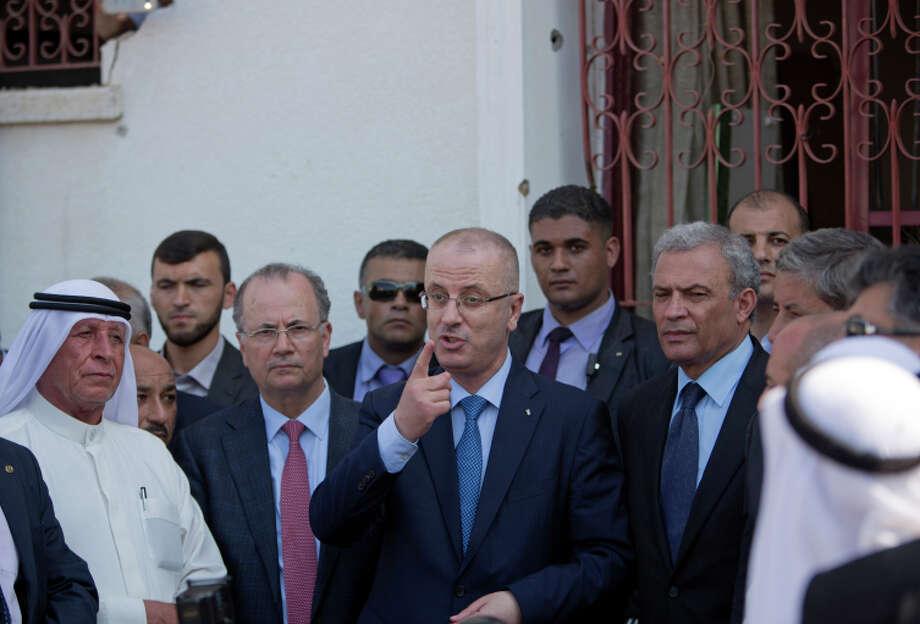 Palestinian Prime Minister Rami Hamdallah visits the Gaza neighborhood of Shijaiyeh. Photo: Khalil Hamra / Associated Press / AP