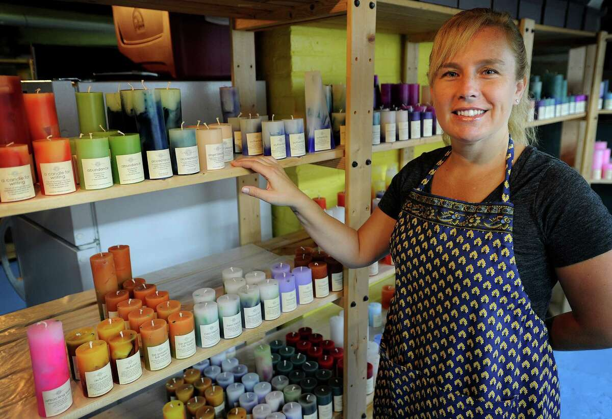 Jenn Heatly, owner of Zena Moon, makes scented candles in the basement of her Norwalk home. Heatly purchased the business, which originated in Spokane, WA, in July of this year.