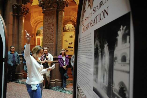 Sandy Westfall, left, gives a Capitol Hauntings Tour at the Capitol Building on Thursday Oct. 9, 2014 in Albany, N.Y.  (Michael P. Farrell/Times Union) Photo: Michael P. Farrell / 10028914A