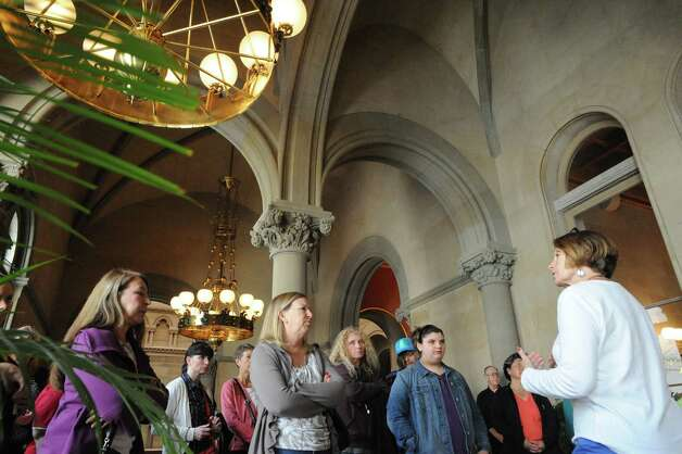 Sandy Westfall, right, gives a Capitol Hauntings Tour at the Capitol Building on Thursday Oct. 9, 2014 in Albany, N.Y.  (Michael P. Farrell/Times Union) Photo: Michael P. Farrell / 10028914A