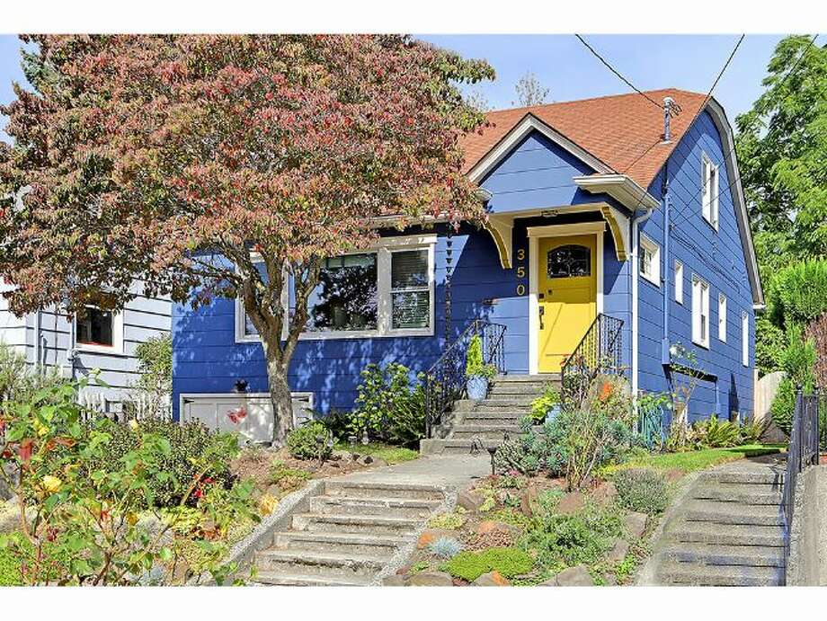 We'll start with the home priced closest to September's median sales price, 350 N.W. 77th St., which is listed for $524,950. The 2,460-square-foot house, built in 1926, has four bedrooms, one bathroom, an unfinished basement and a patio on a 3,708-square-foot lot. Open houses are scheduled for 1 p.m. to 4 p.m., Saturday and Sunday. Photo: Dave Hynden/Windermere Real Estate