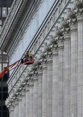 Workers get high above the sidewalk as they work on the Education Building Wednesday morning, Oct. 8, 2014, in Albany, N.Y.   (Skip Dickstein/Times Union) Photo: SKIP DICKSTEIN, ALBANY TIMES UNION