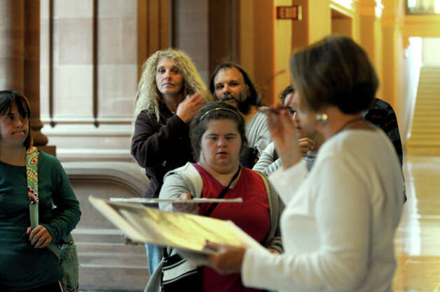 Sandy Westfall, foreground, gives a Capitol Hauntings Tour at the Capitol Building on Thursday Oct. 9, 2014 in Albany, N.Y.  (Michael P. Farrell/Times Union) Photo: Michael P. Farrell, Albany Times Union / 10028914A