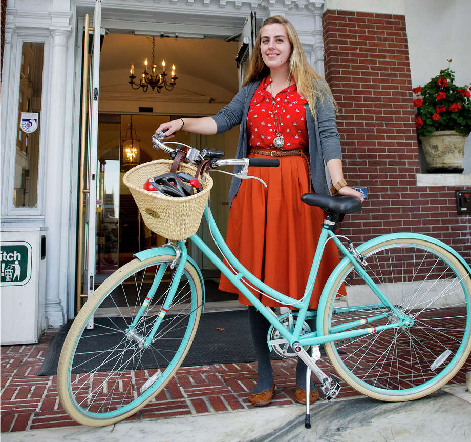Meg Dalton poses for a photo with her bicycle outside the Ferguson Library in Stamford, Conn., on Friday, October 3, 2014. Photo: Lindsay Perry / Stamford Advocate