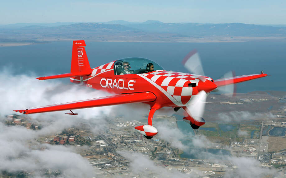 Team Oracle pilot and EAA's Young Eagles chairman Sean D. Tucker flies with Grace Rofii, 11, riding in the front for an introductory flight on Thursday, October 9, 2014 in Oakland, Calif. Photo: Beck Diefenbach / Special To The Chronicle / ONLINE_YES