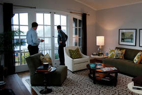 Two men from England admire the view from their rental property in S.F. in October. HomeAway had sued over the city's new ordinance regulating short-term rentals.